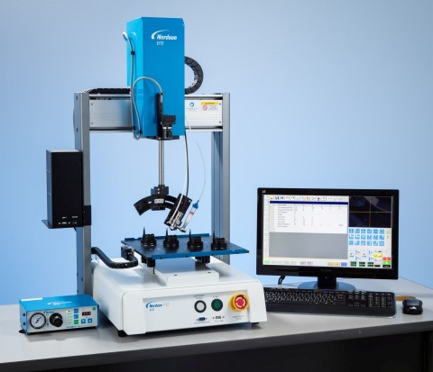 Nordson EFD's 4-axis RV Series automated dispensing robot provides simplified programming with a smart vision camera and proprietary fluid dispensing software. (Photo: Business Wire)