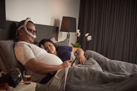 AirFit P30i nasal pillows tube-up CPAP mask, man reading (Photo: Business Wire)