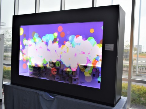 Sharp's groundbreaking displays, including this 90-inch see-through LCD panel open up a new world of display possibilities. (Photo: Business Wire)
