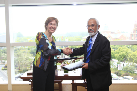 GSMA and Multimedia University of Malaysia to Establish Graduate Programme on Communications Policy and Regulation - Signing with Anne Bouverot, Director General, GSMA and Dr. Osman Mohamad, Dean, Graduate School of Management, Multimedia University of Malaysia. (Photo: Business Wire)